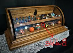 Curved glass marble display case , displays 148 marbles, sol